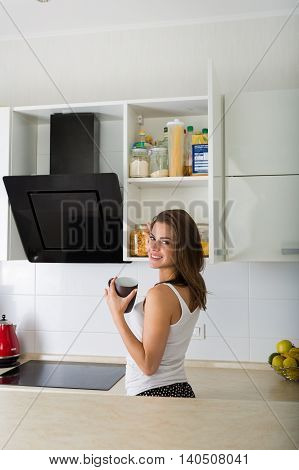 Woman At Her Kitchen In The Morning
