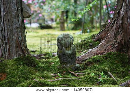 stone sculpture forest spirit. Park in Kyoto. Japan