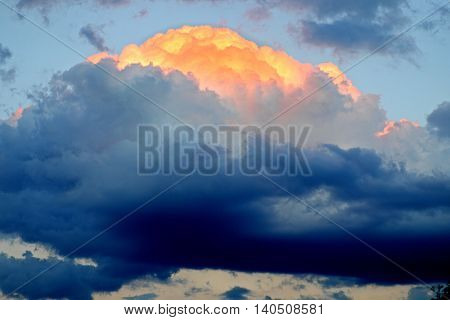 Dark clouds in the sky with a piercing rays of the sun