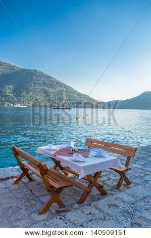 A table in a restaurant on the beach in Montenegro