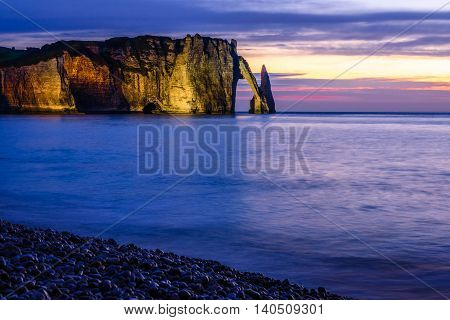 dramatic sunset, Etretat Cliff in Normandy, France