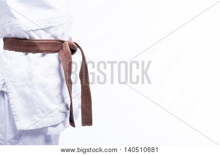 Close up of judo judo-gi whit belt isolated on white background