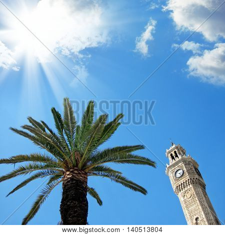 clock tower and palm tree over clear sunny sky in Izmir, Turkey