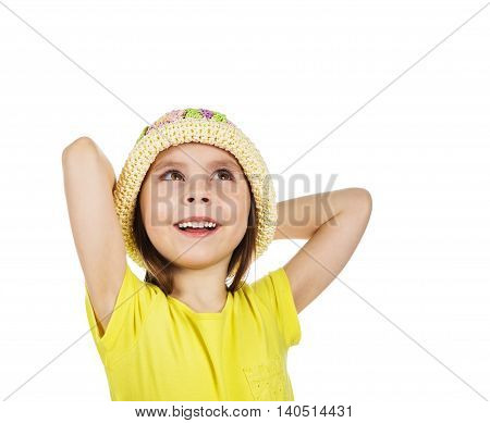Cute little girl with his hands behind his head happily looking up on a white backgroundCute little girl with her hands behind her head happily looking up on a white background.