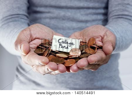 Man holding coins in hands for college expenses