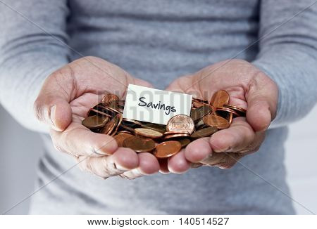 Man holding coins in hand for savings plan
