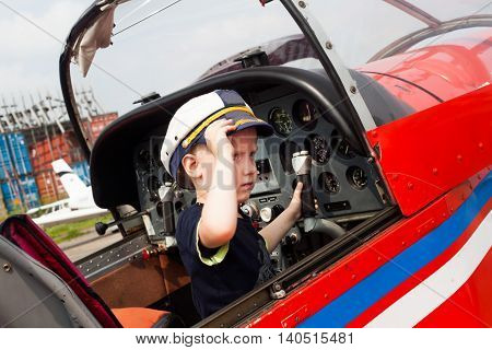 boy pilot a real airplane beautiful wing serious adult steering wheel instruments