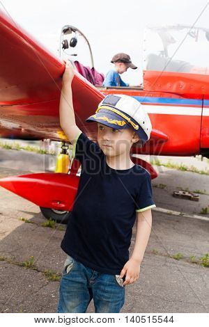 boy pilot a real airplane beautiful wing serious adult