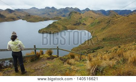 Tourist watching the Parcacocha lagoon in the Cayambe Coca National Park