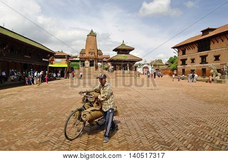 Bhaktapur,np - Circa August 2012 - Man With Bicycle In Durbar Square, Circa August 2012 In Bhaktapur