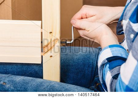 Assembling Wood Furniture Using Hex Key. Diy.