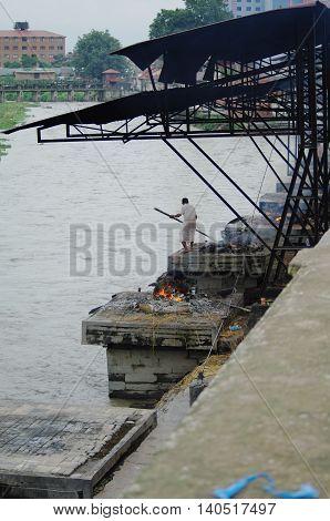 Kathmandu,np Circa August 2012 - Man Burning Corpse In Pashupatinath Temple Circa August 2012 In Kat