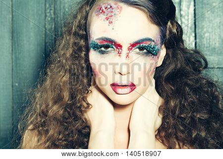 Woman with bright stylish make-up and false fashion feather eyelashes