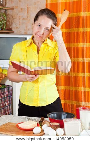 Woman Reading Cookbook