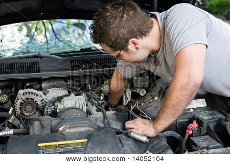 Man Changing Spark Plugs
