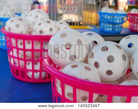 Baskets of wiffle balls at a carnival game with copy space.