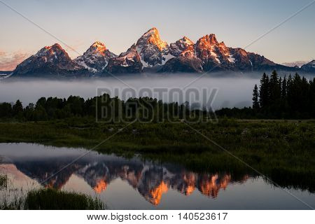 A stunning sunrise at Schwabachers landing in the Grand Teton National Park of Wyoming