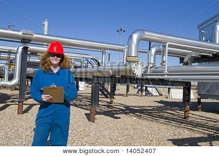 Female Gas Field Operator Inspects Compressor Site