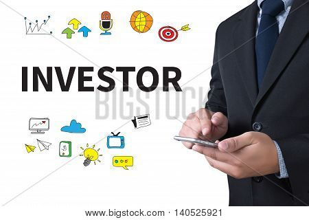 INVESTOR businessman working use smartphone computer top