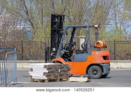 Gas Powered Forklift and Pallet with Cardboard