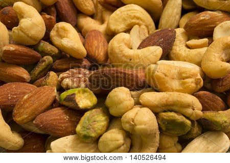 This is a photograph of mixed nuts including Cashews,Almonds,Pistachios, and Pecans