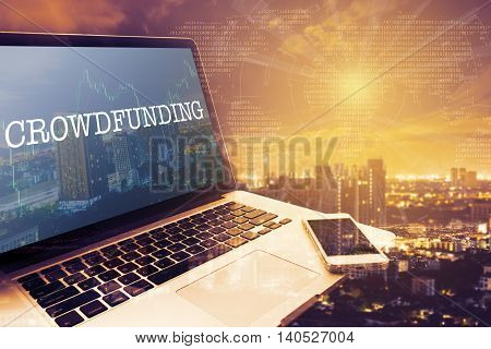 CROWDFUNDING : Grey screen laptop computer. Vintage effects. Digital Business and Technology Concept.