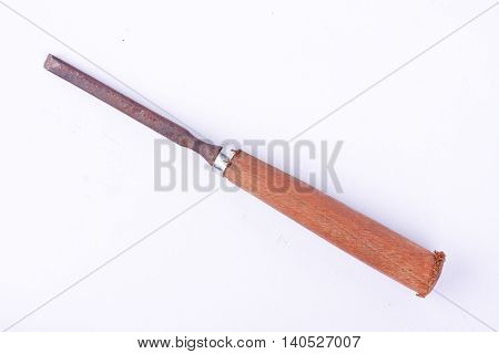 small old used flat chisel wood carving woodworking tools on white background rust carpentry tool isolated