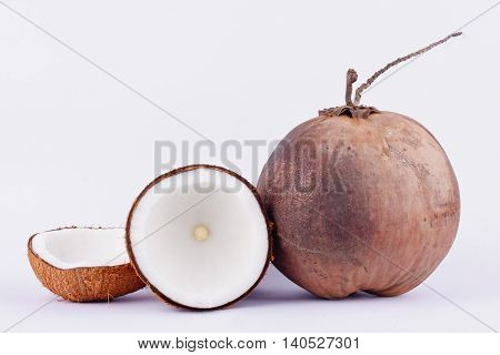coconut half clipping path for coconut milk and brown coconut shell and ripe coconut  on white background healthy fruit food isolated