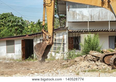 bucket excavator destruction in work outdoor construction and  dust soil motion