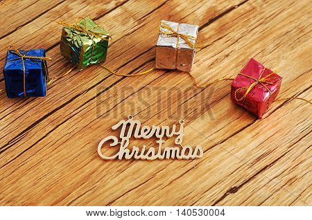 Small little gifts wrap in Shiny paper with merry christmas text