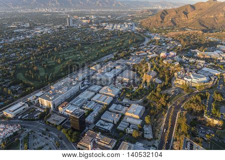Los Angeles, California, USA - July 21, 2016:  Late afternoon aerial of Universal City Studios, Burbank and Griffith Park.