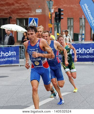 STOCKHOLM - JUL 02 2016: Running triathletes Le Corre and competitors in the old town of Stockholm in the Men's ITU World Triathlon series event July 02 2016 in Stockholm Sweden