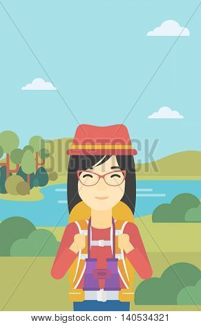 An asian woman with backpack walking in the mountains. Female backpacker with binoculars. Female traveler hiking in mountains. Vector flat design illustration. Vertical layout.