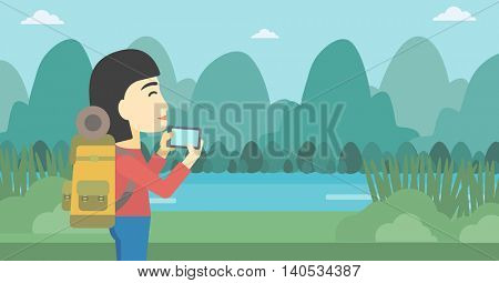 An asian woman taking photo of landscape with mountains. Young hiking woman with backpack taking photo with her cellphone. Vector flat design illustration. Horizontal layout.