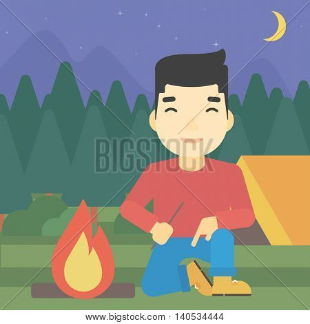 An asian man kindling a campfire on the background of camping site with tent. Tourist relaxing near campfire. Vector flat design illustration. Square layout.