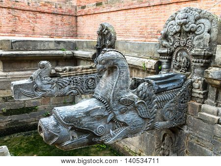 HIstoric ancient Tap made of stone in Patan Durbar SqureNepal.