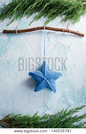 Christmas star hanging decoration on rustic wall