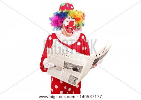 Clown reading a newspaper isolated on white background