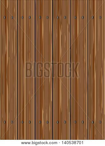 A fence made of softwood planks showing the wood grain