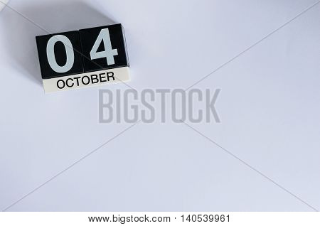 October 4th. Day 4 of month, wooden color calendar on white background. Autumn time. Empty space for text,