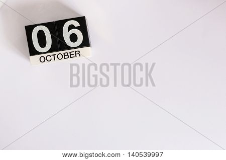 October 6th. Day 6 of month, wooden color calendar on white background. Autumn time. Empty space for text.