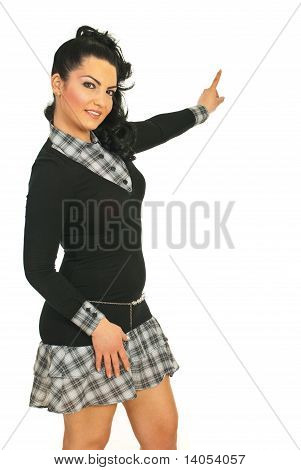 Attractive Woman Pointing To Copy Space