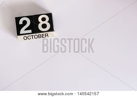 October 28th. Day 28 of month, wooden color calendar on white background. Autumn time. Empty space for text.
