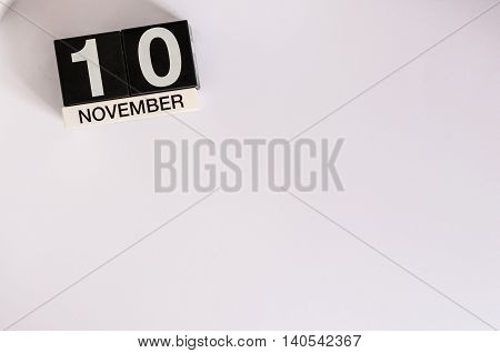 November 10th. Day 10 of month, wooden color calendar on white background. Autumn concept. Empty space for text