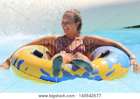 Rhodes Greece-July 7 2016:The girl after rafting slide in the Water park.Rafting slide is one of many popular game for adults and children in park.Water Park on the island of Rhodes in Greece and one of the most popular in Greece