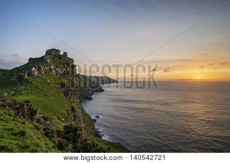 Landscape Image Of Valley Of The Rocks In Devon During Summer Sunset.