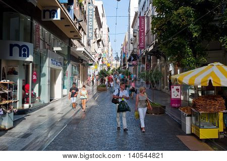 ATHENS-AUGUST 22: Shopping on Ermou Street with various shops on August 22 2014 in Athens Greece. Ermou street is a main shopping street in Athens.