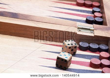 Wooden handmade backgammon board with chips  and two dices
