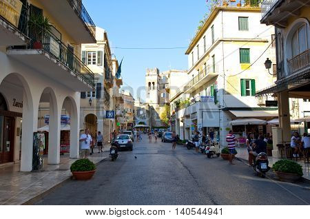 CORFU-AUGUST 27: Kerkyra old town in the midday with the row of souvenirs shops on August 27 2014 on Corfu island Greece.