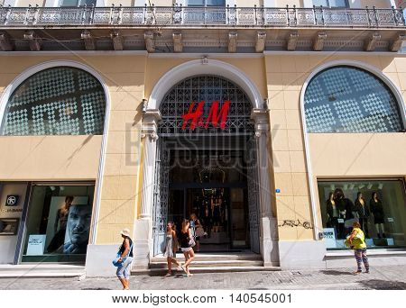 ATHENS-AUGUST 22: H&M shop on Emrou street on August 222014 Athens Greece. H & M is a Swedish retail-clothing company known for its fast-fashion clothing for men women and children.